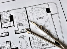 A compass on the top of the residence floorplan. A compass on the top of the floorplan Royalty Free Stock Image