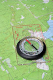 Compass on topographic map Stock Photos