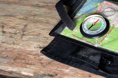 Compass on topographic map. Stock Photography