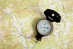 Compass on a topographical map Royalty Free Stock Photography