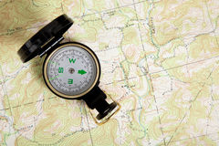 Compass on a topographical map Stock Photography