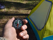 Compass and tourist tent. Stock Image