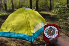 Compass and tourist tent. Royalty Free Stock Photos