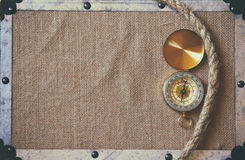 Compass and a traveler rope on burlap canvas. explorer concept Stock Image