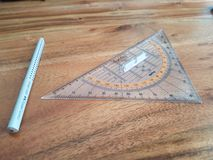 Compass with triangular protractor Royalty Free Stock Photography