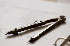 Compass and trigonometry notes. A compass on a notebook of trigonometry notes Stock Photography
