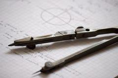 Compass and trigonometry notes. A compass on a notebook of trigonometry notes Stock Photo