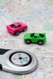 Compass and two cars, on the map Royalty Free Stock Photo