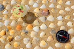 Compass, Umbrella and Seashells Stock Photo