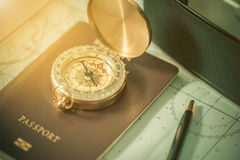 Compass on a US passport and map with blurred old camera. Royalty Free Stock Photo