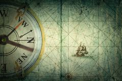 Compass on vintage map. Adventure, stories background. Compass on vintage map. Adventure, travel, stories background Royalty Free Stock Images