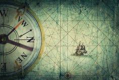 Compass on vintage map. Adventure, travel, stories background. Old brass compass on grunge vintage map. Adventure, travel, stories background Stock Photo