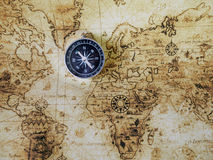 Compass on vintage map. Retro styl Stock Photos