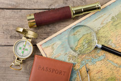 Compass and vintage map on the wooden desk Stock Image