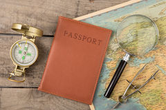 Compass and vintage map on the wooden desk Stock Photography