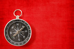 Compass on the vivid red background Stock Image