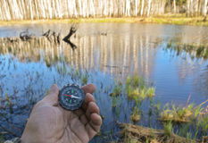 With compass on the walk. Royalty Free Stock Photography