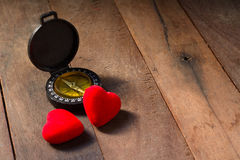 Compass whit harts on wood blackground Royalty Free Stock Photo
