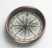 Compass on white. Brass compass  on white background Royalty Free Stock Photo