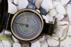 Compass on white pebbles Royalty Free Stock Images
