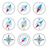 Compass and Windrose Thin Line Icons Set. Compass thin line icons set. Vector icons of a navigational compass in outline style. Windrose design elements. Compass Royalty Free Stock Photos