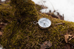 Compass in winter forest Royalty Free Stock Photography
