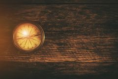 Compass and Wood Background Royalty Free Stock Photo