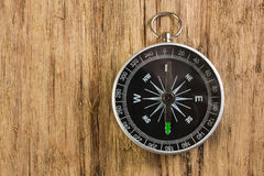 Compass on wooden background Royalty Free Stock Image