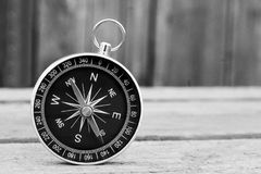 Compass on wooden background. Travel object, so close Royalty Free Stock Images