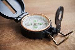 Compass in a wooden background Royalty Free Stock Image