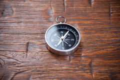 Compass on wooden background Stock Photo