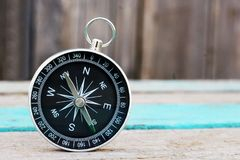 Compass on wooden background. Travel object, so close Royalty Free Stock Image