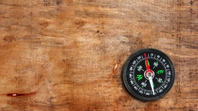 Compass on the wooden surface royalty free stock photography