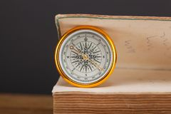 Compass on wooden table. Background discovery navigate north travel map brown east geography journey latitude navigation old south west longitude retro text stock image