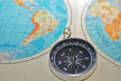 Compass and the world. Royalty Free Stock Image