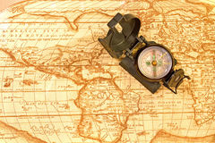 Compass on world map. Compass on ancient world map Royalty Free Stock Images