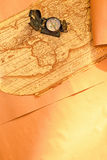 Compass on world map. Compass on ancient world map and parchment paper, focus on compass Stock Photography