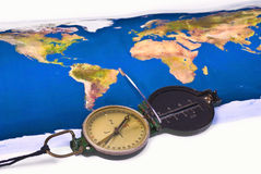 Compass and world map. In background royalty free stock photography