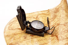 Compass on world map. Compass on ancient world map Royalty Free Stock Image