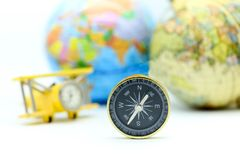 Compass with world map and mini airplane, Adventure stories,Tour Stock Photography