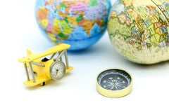 Compass with world map and mini airplane, Adventure stories,Tour Royalty Free Stock Photo