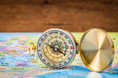 Compass on world map. Royalty Free Stock Photo