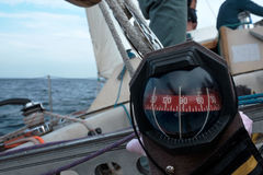 Compass on a yacht boat a blue summer sea ocean day Stock Image