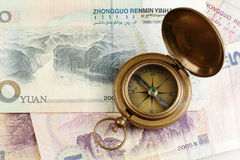 Compass and yuans money Stock Images