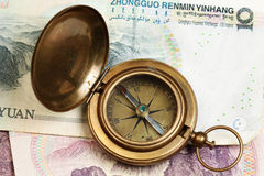 Compass and yuans money Royalty Free Stock Photo