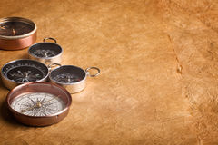 Compasses. Various compasses on a weathered paper background Stock Image