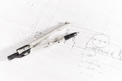Compasses. On engineer paper closeup Royalty Free Stock Images