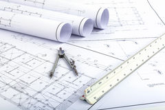 Compasses and Architect scale ruler on plan drawing Royalty Free Stock Photos