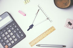 Compasses and calculator Stock Photography