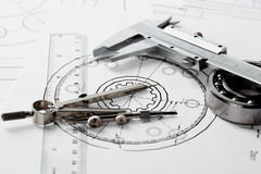Compasses and the drawing. Stock Image